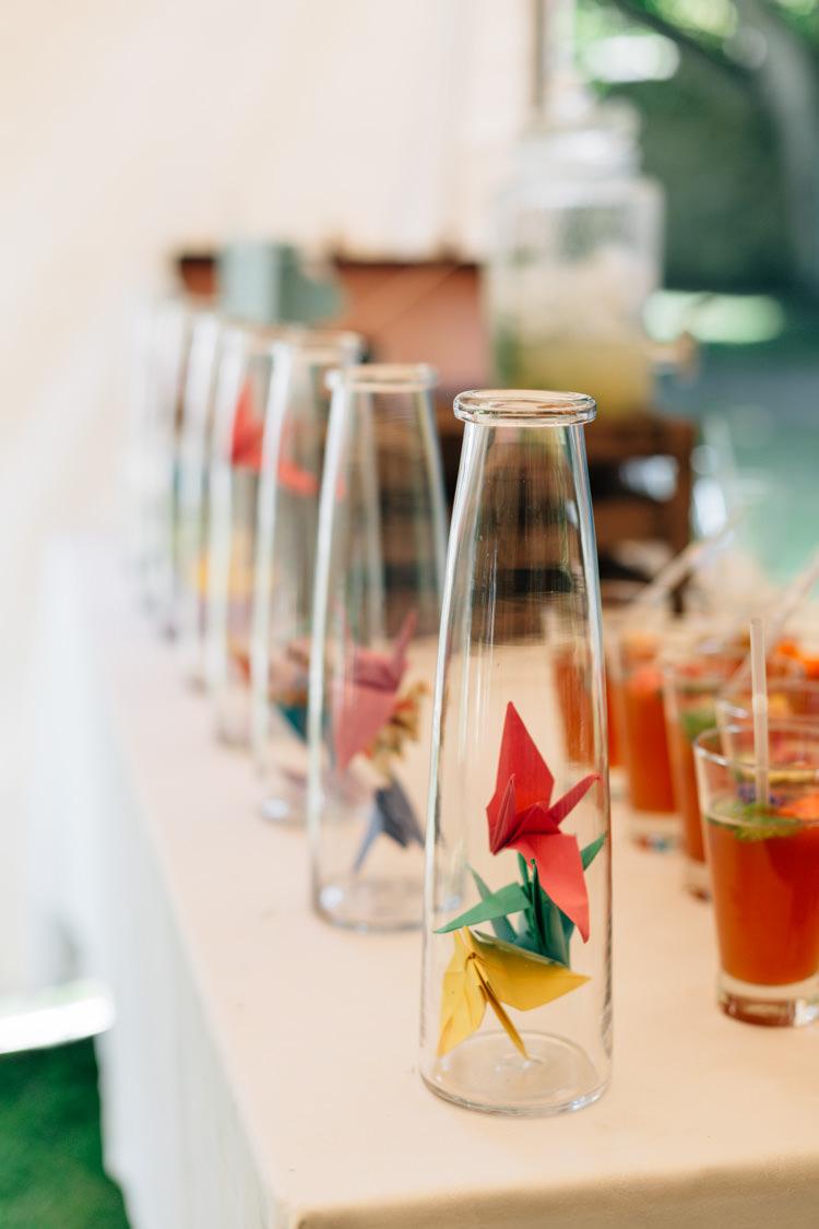 Paper Cranes Bottles Decor Bohemian Origami Guernsey Wedding http://janiceyiphotography.ca/