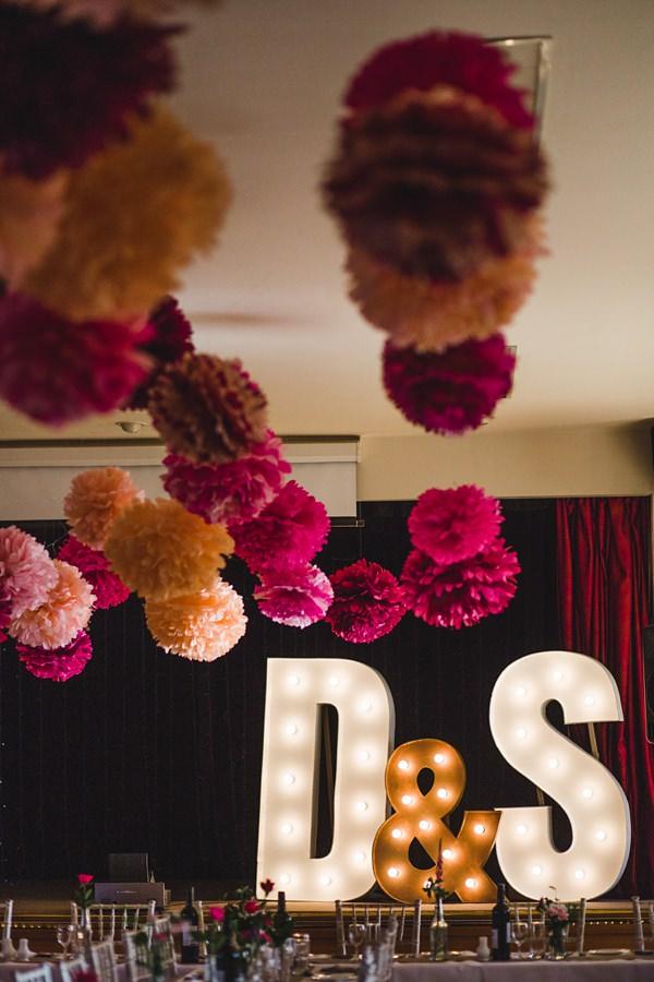 Pink Pom Poms Wedding Ideas Lights Hall http://www.lolarosephotography.com/