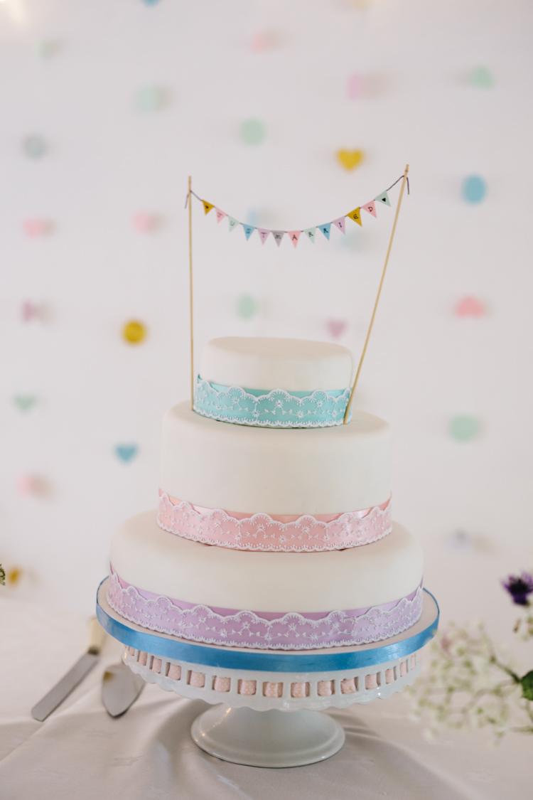 Ribbons Bunting Cake Relaxed DIY Pastel Wedding http://www.honeyandthemoonphotography.co.uk/