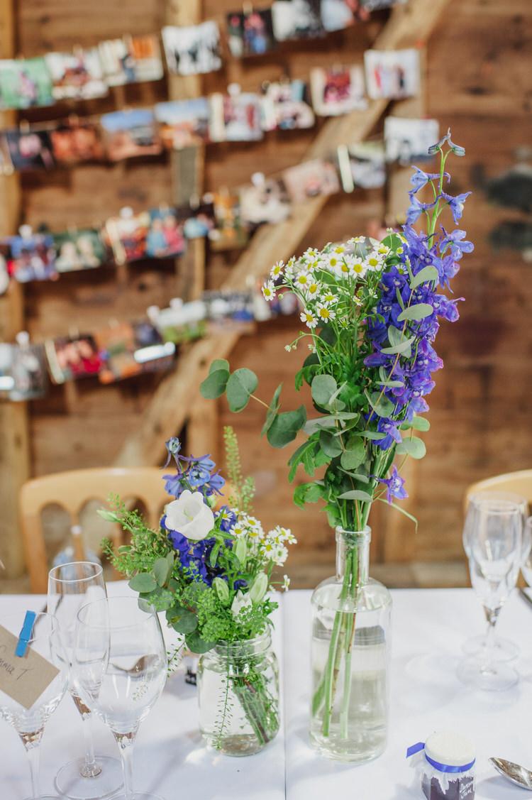Bottle Flowers White Pretty Blue Country Barn Spring Wedding http://karenflowerphotography.com/