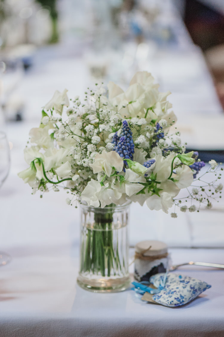 White Flowers Jars Centrepiece Tables Decor Pretty Blue Country Barn Spring Wedding http://karenflowerphotography.com/