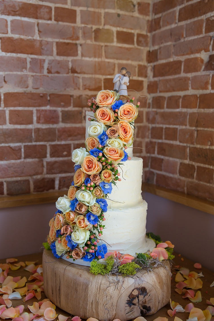 Butter Cream Cake Flowers Ivory Peach Blue Log Natural Soft Stylish Luxe Wedding http://www.katherineashdown.co.uk/