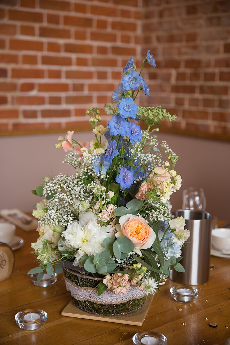 Peach Blue Ivory Flowers Centrepiece Log Natural Soft Stylish Luxe Wedding http://www.katherineashdown.co.uk/