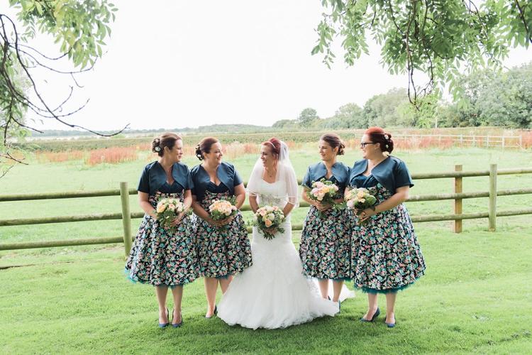 Rustic floral peach marquee wedding whimsical wonderland for Lindy bop wedding dress