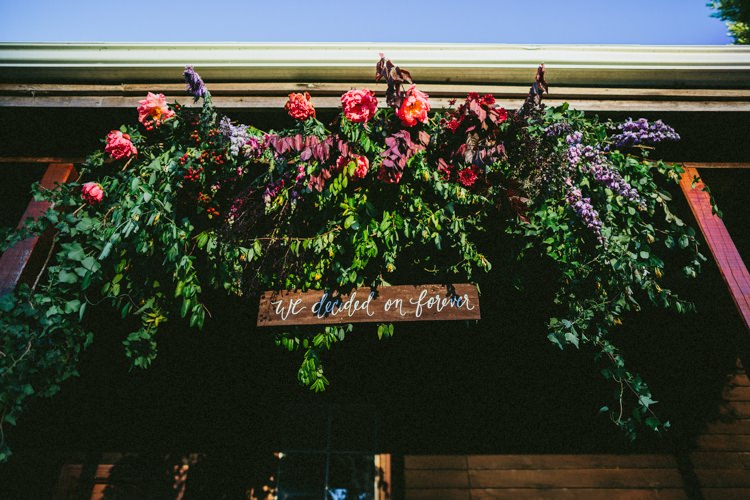 Flower Arch Wooden Sign Rustic Ceremony Whimsical Barn Wedding Australia http://throughthewoodsweran.co.uk/