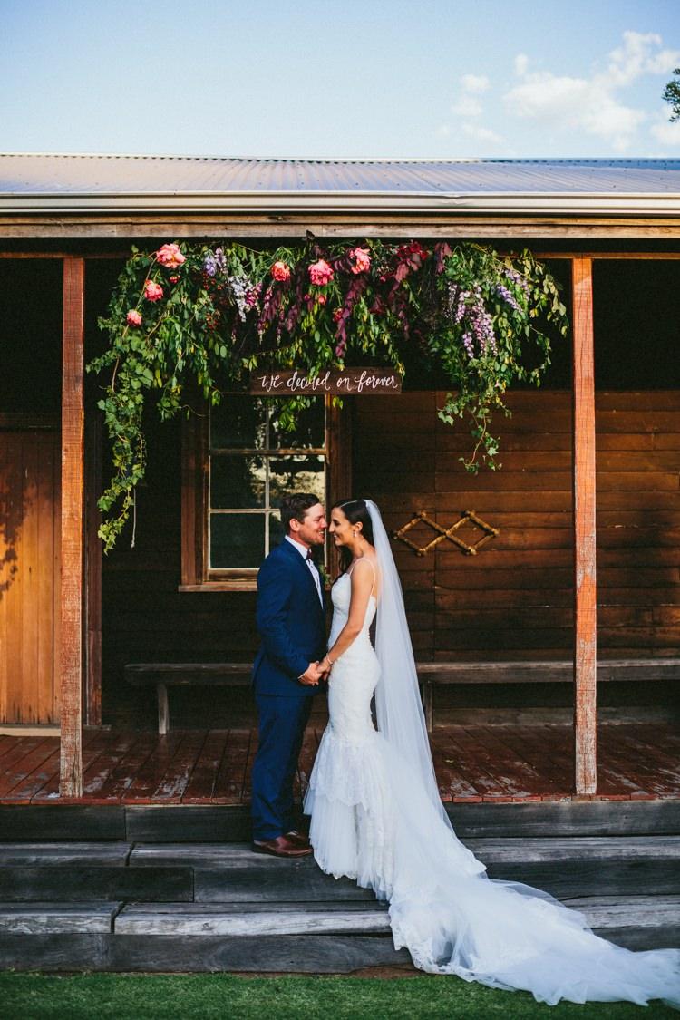 Flower Arch Ceremony Wooden Sign Whimsical Barn Wedding Australia http://throughthewoodsweran.co.uk/