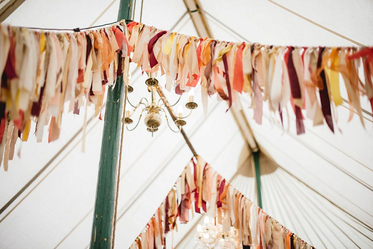 Rag Bunting Orange Coral Marquee Laid Back Bohemian Festival Wedding http://benjaminmathers.co.uk/