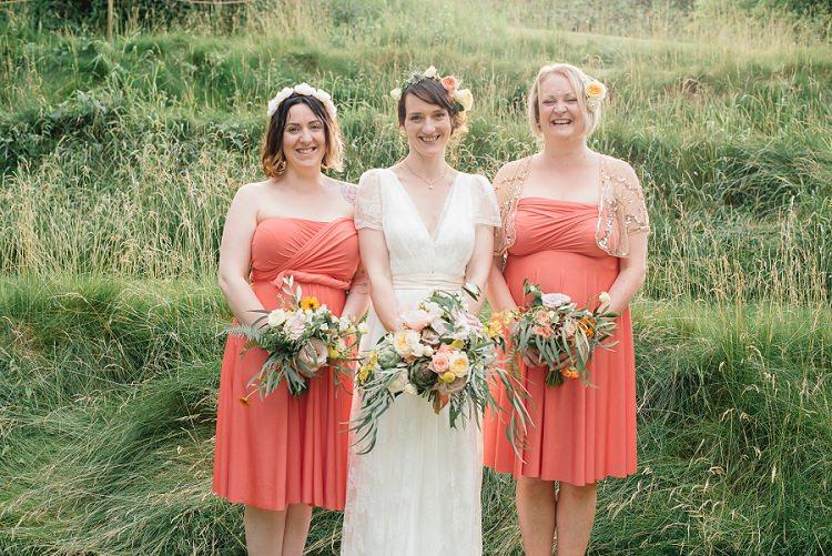 Coral Twist Short Bridesmaid Dresses Orange Laid Back Bohemian Festival Wedding http://benjaminmathers.co.uk/