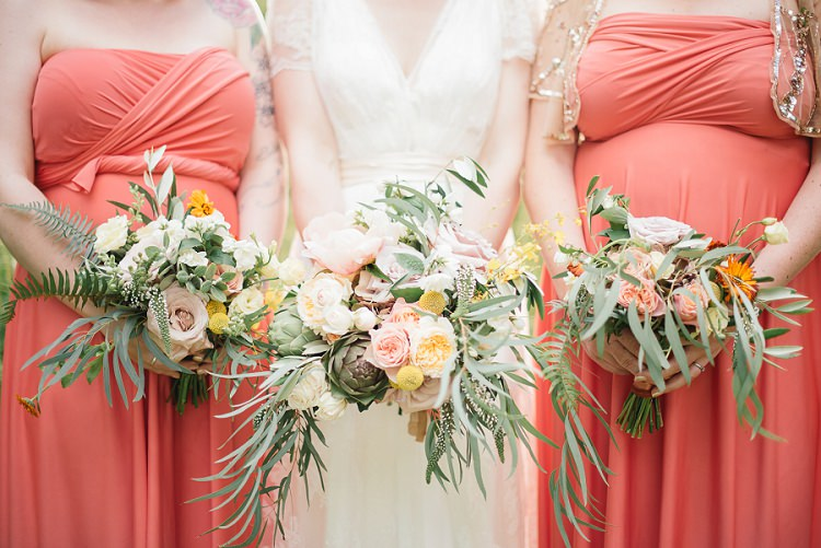 Bridesmaids Bouquets Flowers Coral Peach Yellow Whimsical Foliage Laid Back Bohemian Festival Wedding http://benjaminmathers.co.uk/