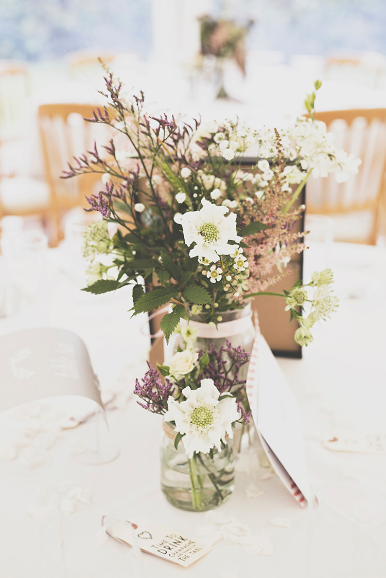 Flowers Jars Centrepiece Tables Stylish Relaxed Fun Marquee Wedding http://www.bennicarolweddingphotography.com/