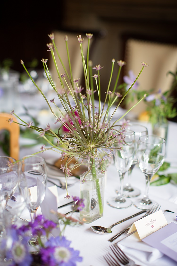 Glass Bottle Flowers Natural Ethereal Purple Wedding http://www.katherineashdown.co.uk/