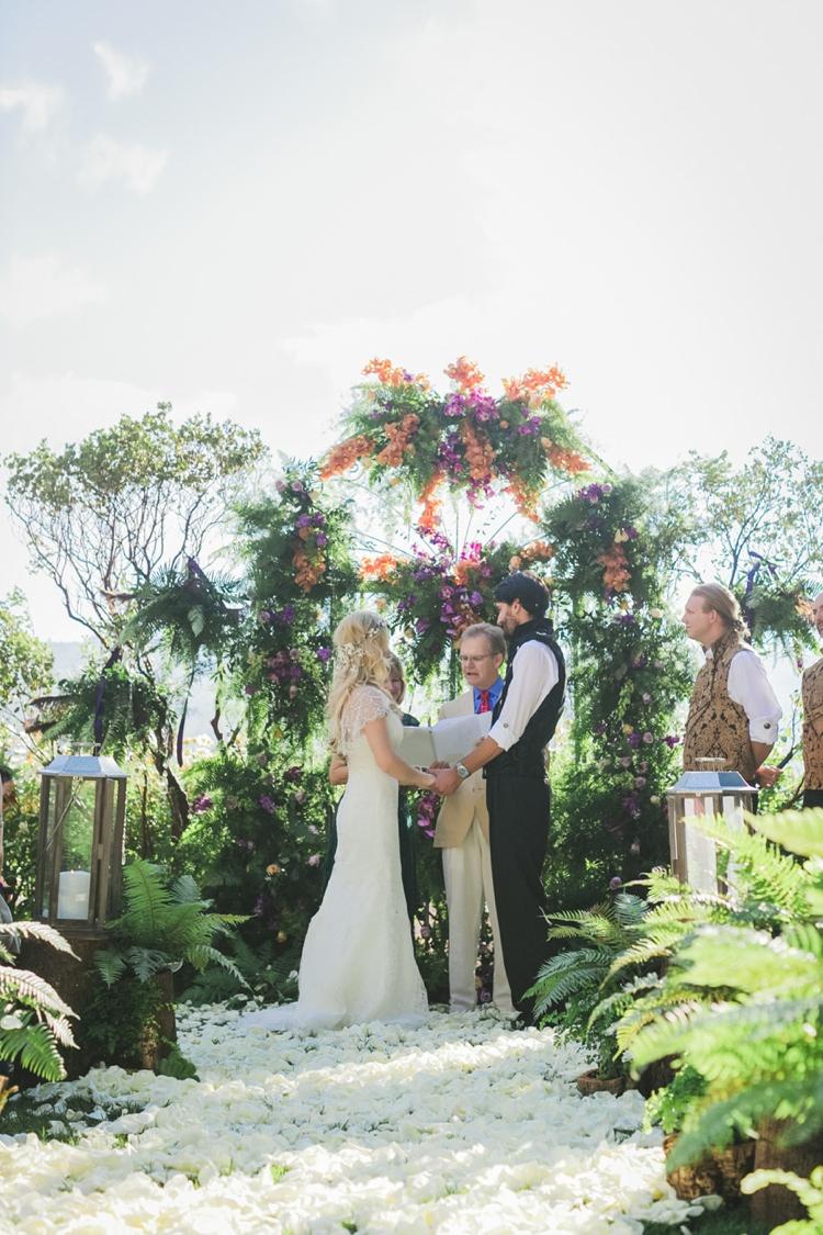 Flower Floral Arch Aisle Petals Backdrop Fantastical Woodland Renaissance Wedding in California http://www.milouandolin.com/