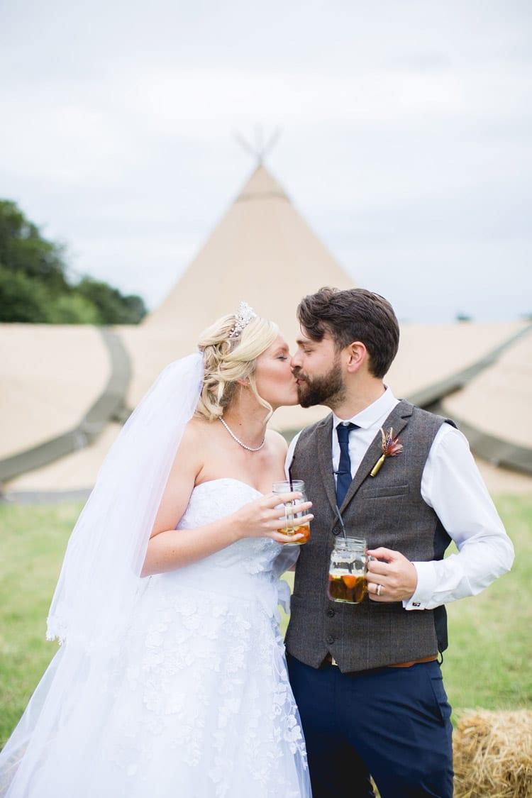 Jar Drinks Tipi Pimms Bride Groom Family Farm Festival Wedding https://amylouphotography.co.uk/