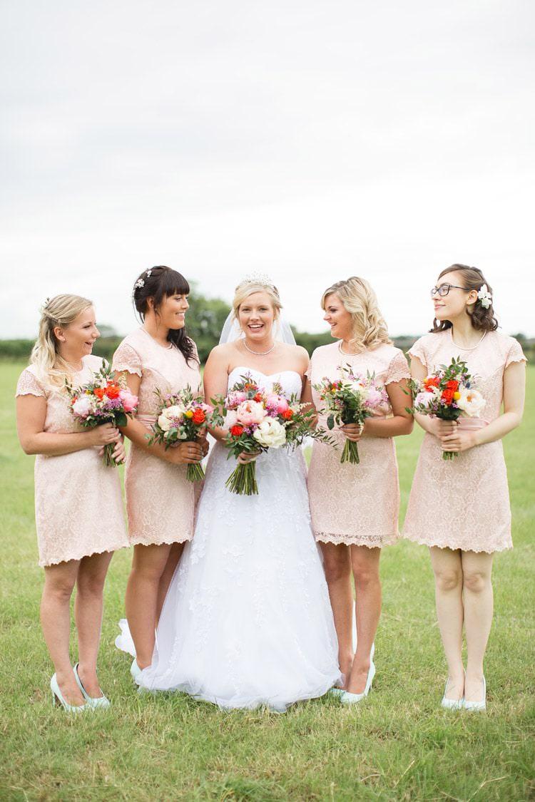Short Lace Blush Bridesmaid Dresses Family Farm Festival Wedding https://amylouphotography.co.uk/