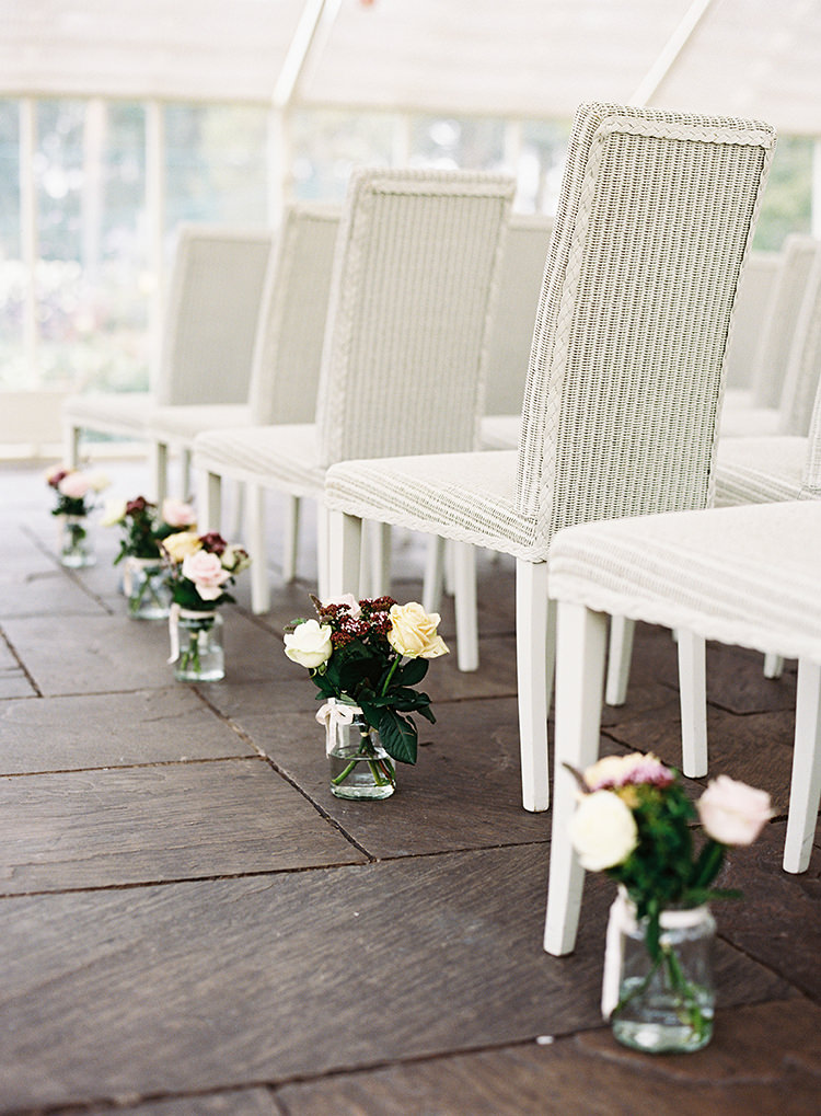 Aisle Jar Flowers Ceremony Chairs Pretty Floral Wonderland DIY Wedding http://www.victoriaphippsphotography.co.uk/