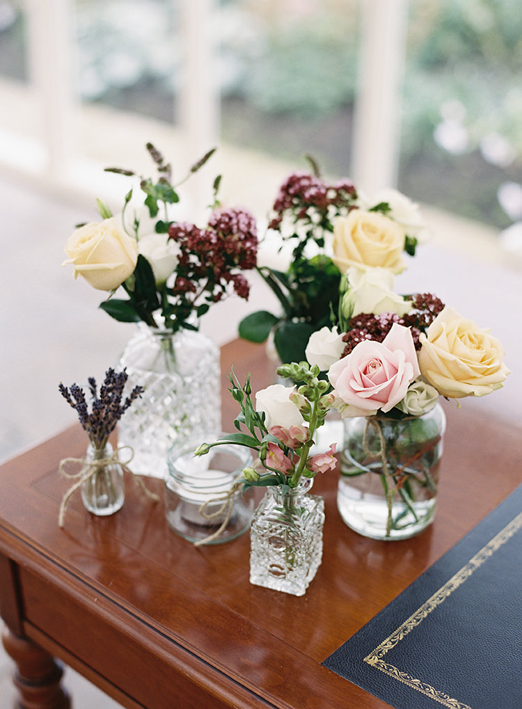 Flowers Bottle Jars Pink Cream Roses Pretty Floral Wonderland DIY Wedding http://www.victoriaphippsphotography.co.uk/