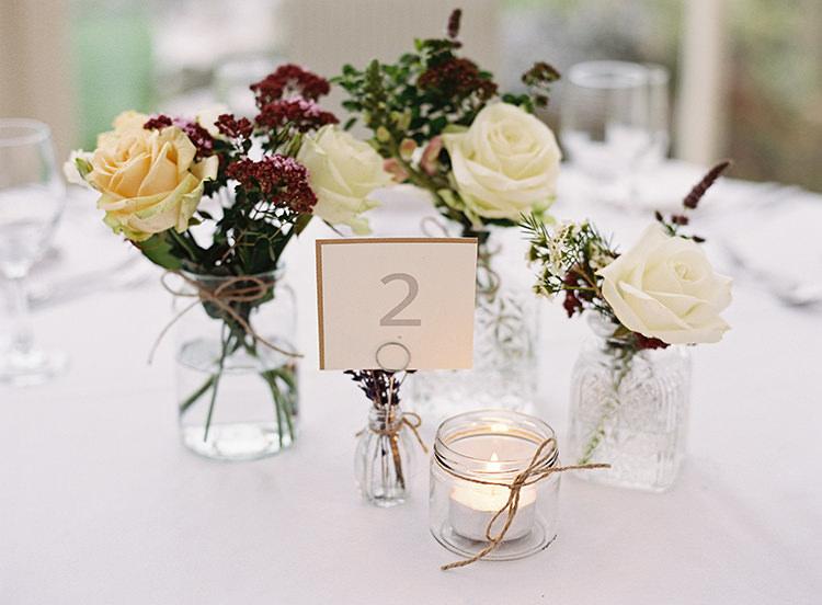 Glass Bottle Jar Flwoers Centrepiece Candle Tea Light Pretty Floral Wonderland DIY Wedding http://www.victoriaphippsphotography.co.uk/