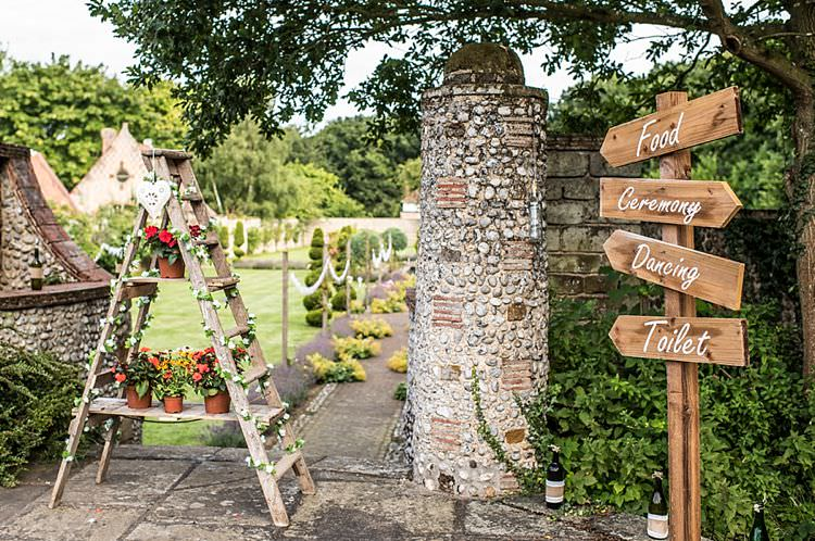 Ladder Decor Flowers Rustic Sign Wooden Post Outdoor Festival Summer Wedding http://lighteningphotography.co.uk/