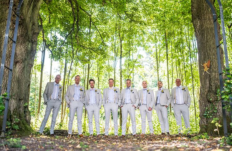 Pale Next Suits Groomsmen Braces Bow Ties Yellow Outdoor Festival Summer Wedding http://lighteningphotography.co.uk/