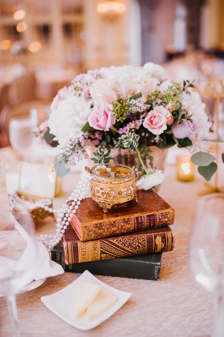 Reception Table Setting Flowers Pearls Vintage Books Candles Opulent Pink Gold Victorian Wedding in Seattle http://www.barrieannephotography.com/