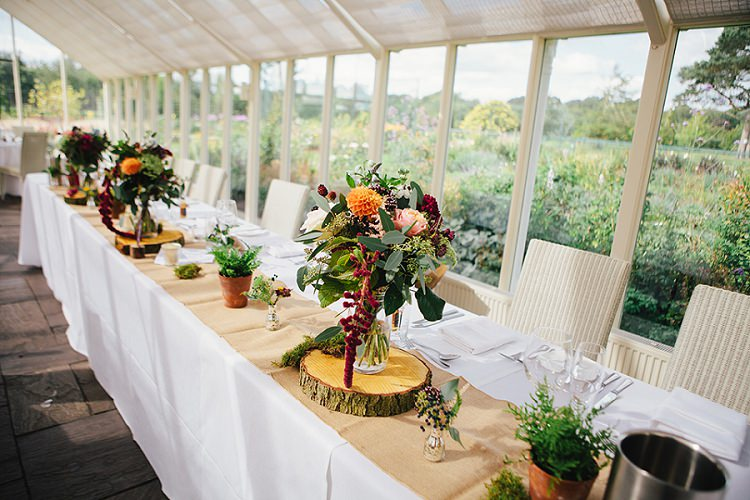 Top Table Log Slice Flowers Hessian Burlap Rustic Woodland Floral Wedding http://kellyjphotography.co.uk/