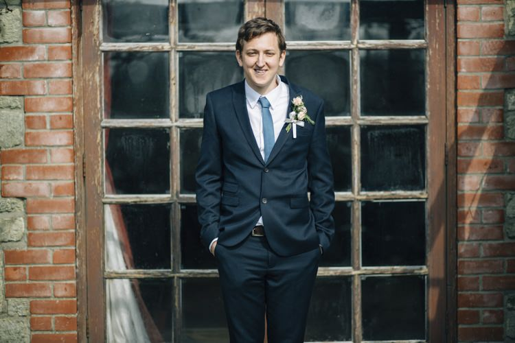 Navy Suit Blue Tie Groom Wild Flowers Outdoors Heartfelt DIY Wedding http://www.mattandesther.co.uk/