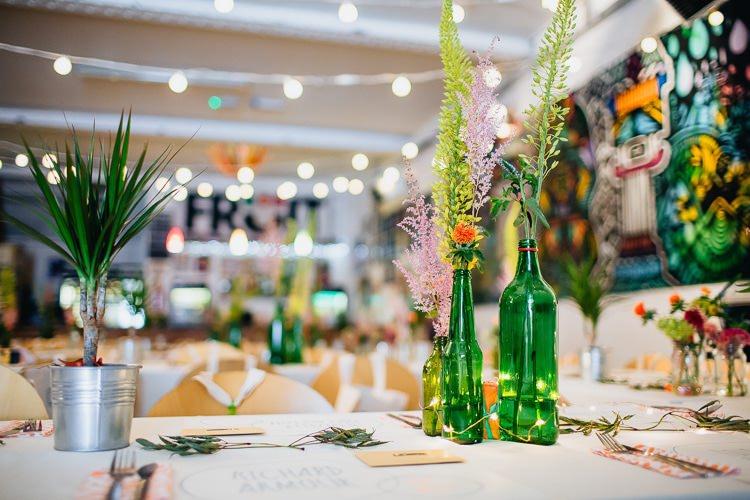 Bottle Flowers Creative Warehouse Eclectic Wedding http://sarahbethphoto.co.uk/
