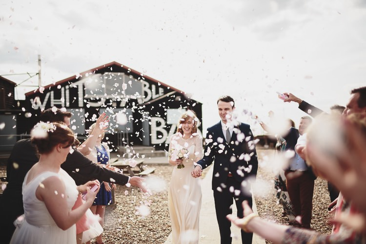 Confetti Throw Bride Groom Free Spirited Beautiful Beach Wedding https://www.paulfullerkentphotography.com/