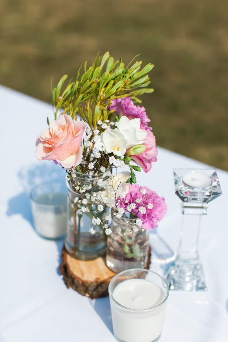 Flowers Log Jars Centrepiece Fresh Pretty Humanist Wedding http://summerlilystudio.com/