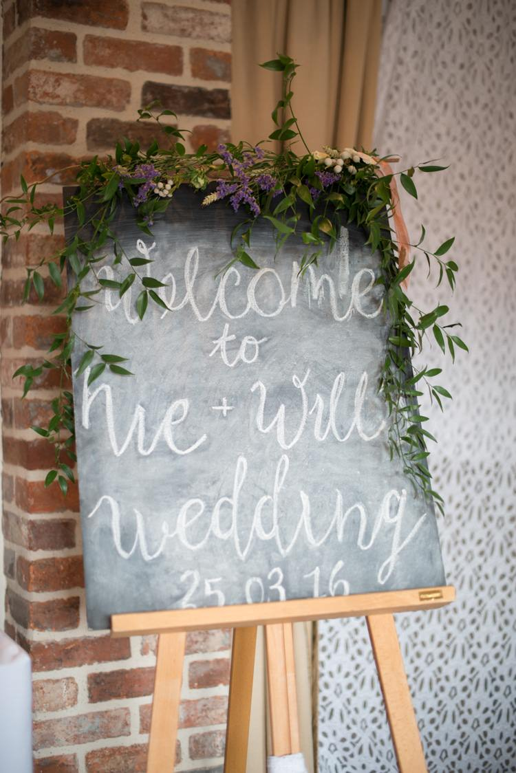 Black Board Chalk Sign Welcome Foliage Calligraphy Copper Dusky Lilac Grey Rustic Barn Wedding http://www.kayleighpope.co.uk/