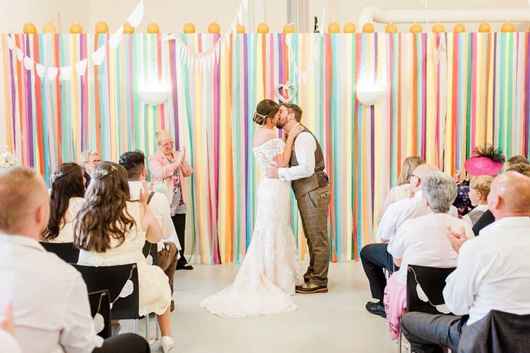 Rainbow Streamer Backdrop Ceremony Multicoloured DIY Rustic Wedding http://vickylamburn.com/