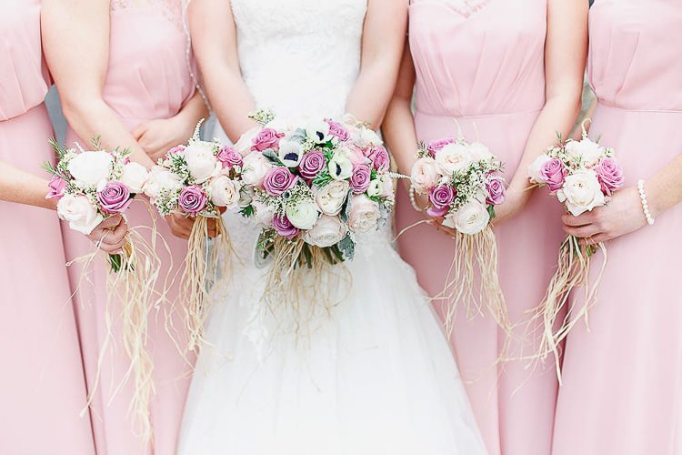 Bouquets Roses Bride Bridesmaids Raffia Outdoorsy Nature Pretty Pink Wedding http://whitestagweddings.com/