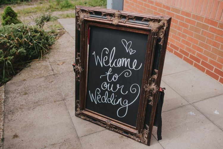 Black Chalk Board Welcome Sign Calligraphy Whimsical Bright Village Hall Wedding http://www.beckyryanphotography.co.uk/