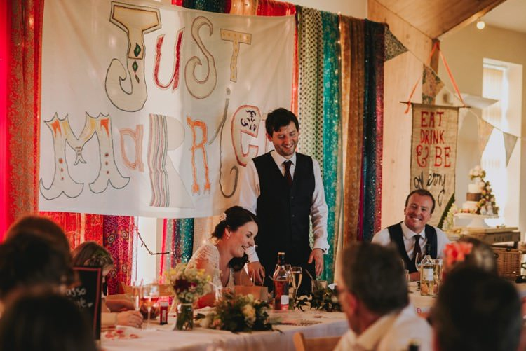 Just Married Top Table Backdrop Sign Whimsical Bright Village Hall Wedding http://www.beckyryanphotography.co.uk/