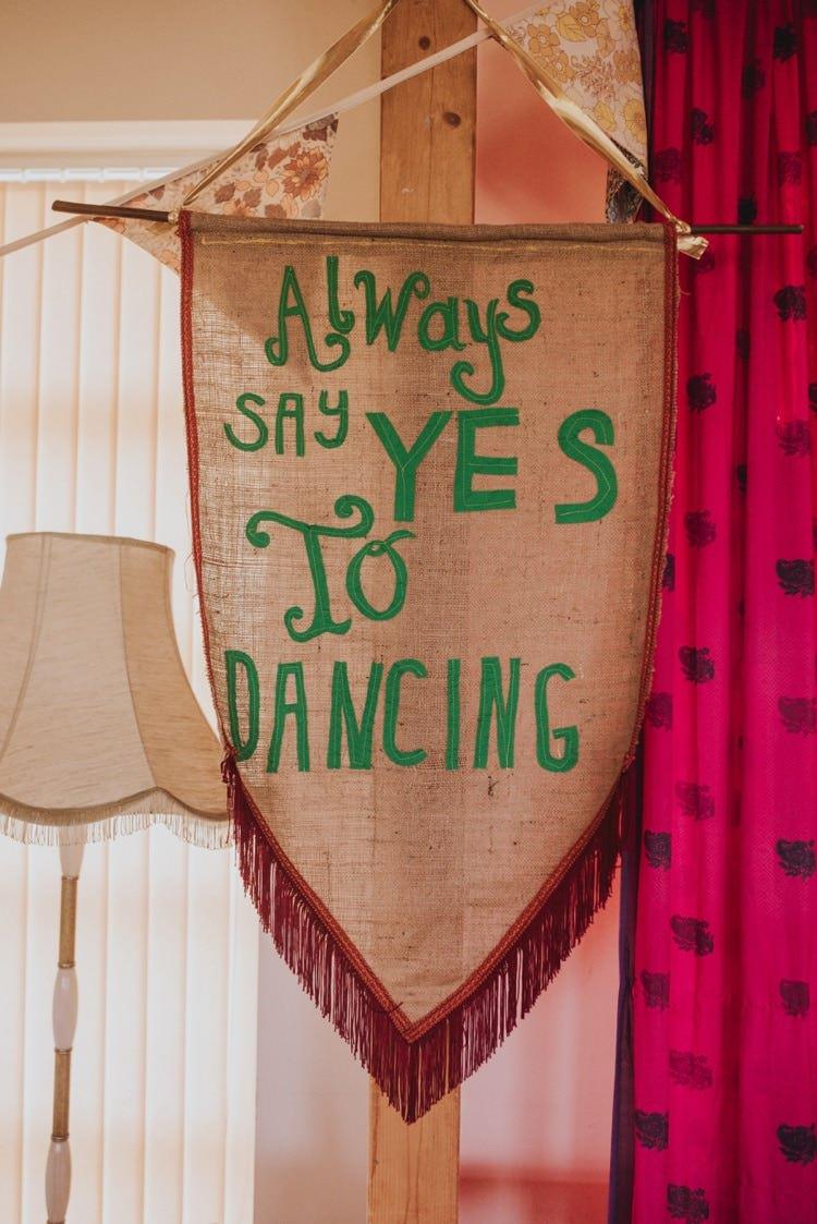 Dancing Banner Fabric Tassel Whimsical Bright Village Hall Wedding http://www.beckyryanphotography.co.uk/