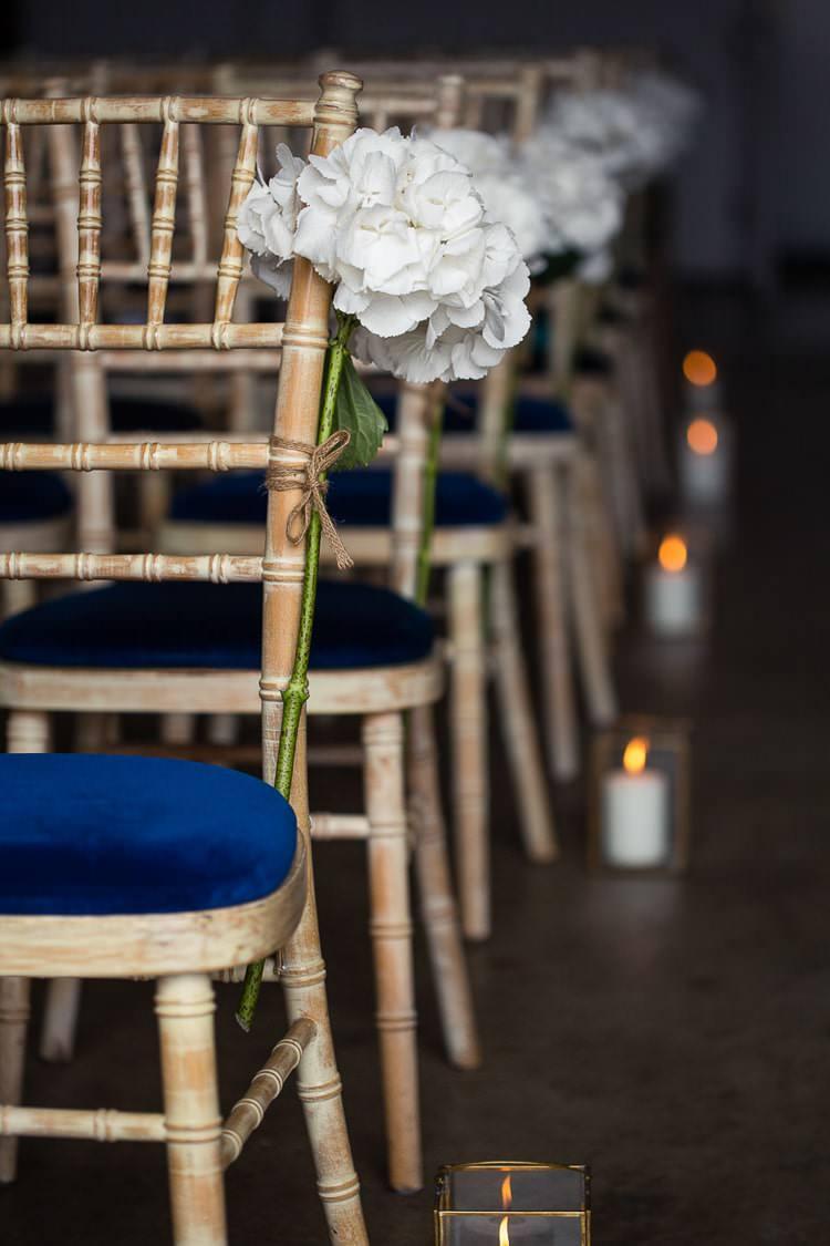 White Hydrangea Flower Pew End Chair Aisle Urban London Stylish Navy White Wedding http://karibellamy.com/