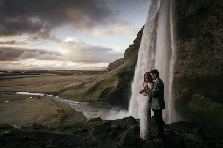 Bride Groom Waterfall Rocks Clouds Glacier Lagoon Iceland Anniversary Shoot http://marcsmithphotography.com/