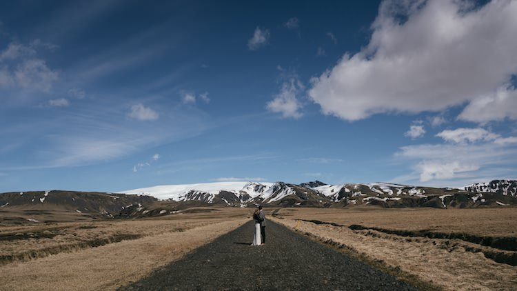 Bride Groom Deserted Road Mountains Snow Blue Sky Clouds Glacier Lagoon Iceland Anniversary Shoot http://marcsmithphotography.com/