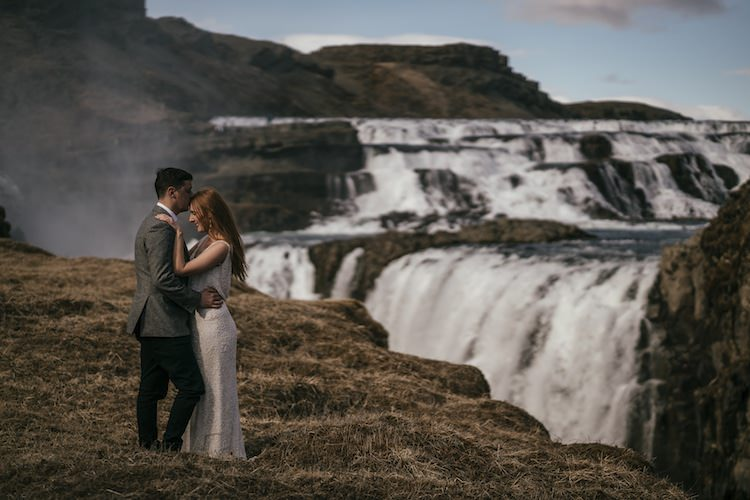 Outdoor Vow Renewal Bride Beaded Stephanie Allin Bridal Gown Groom Grey Tweed Jacket Skinny Jeans Waterfalls Landscape Glacier Lagoon Iceland Anniversary Shoot http://marcsmithphotography.com/