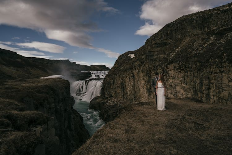Bride Groom Mountains Waterfalls Blue Sky Clouds Landscape Glacier Lagoon Iceland Anniversary Shoot http://marcsmithphotography.com/