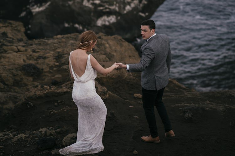 Bride Stephanie Allin Beaded Low Back Bridal Gown Groom Grey Tweed Jacket Skinny Jeans Cliff Ocean Glacier Lagoon Iceland Anniversary Shoot http://marcsmithphotography.com/