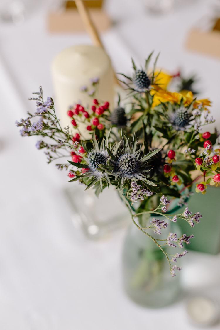 Thistle Sunflowers Centrepiece Table Flowers Informal Vintage Personal Wedding http://www.marknewtonweddings.co.uk/