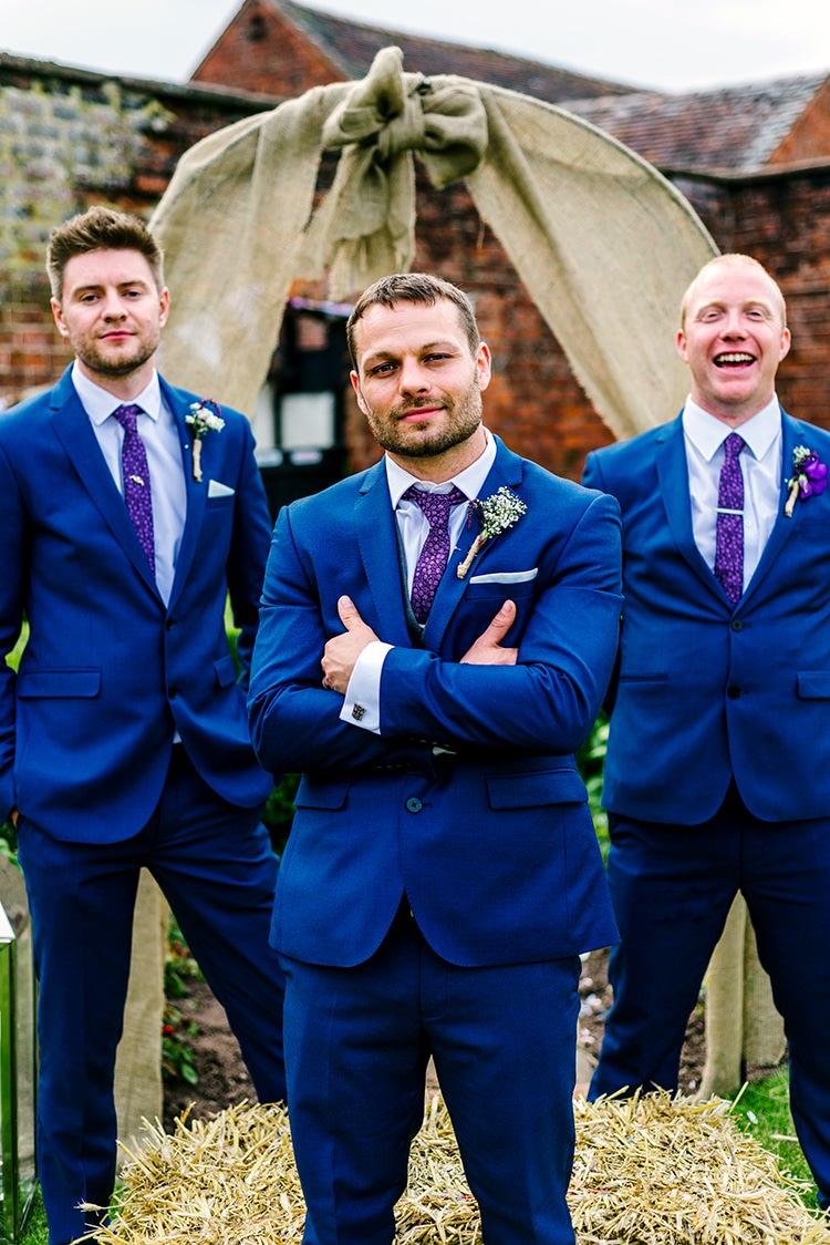 Groom Groomsmen Blue Suit Burton Purple Tie Rustic Relaxed Country Garden Wedding http://www.dmcclane.com/