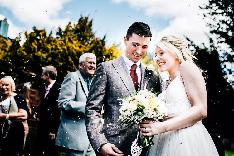 Confetti Throw Dreamy Stylish Barn Wedding http://www.faircloughphotography.co.uk/