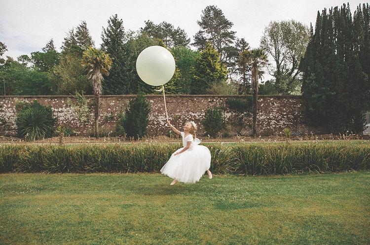 Flower Girl Giant Balloon Playful Peach Wedding Ideas http://www.kelleequinnphotography.com/