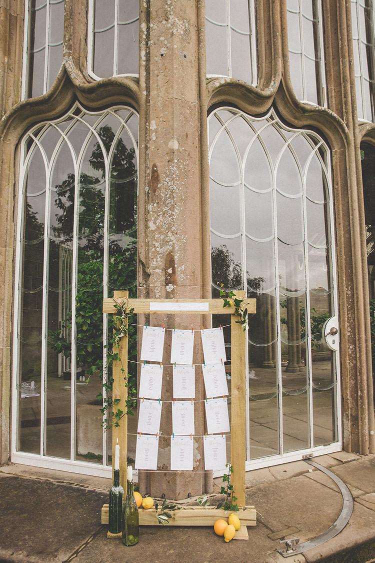 Wooden Frame Seating Table Plan Chart Playful Peach Wedding Ideas http://www.kelleequinnphotography.com/