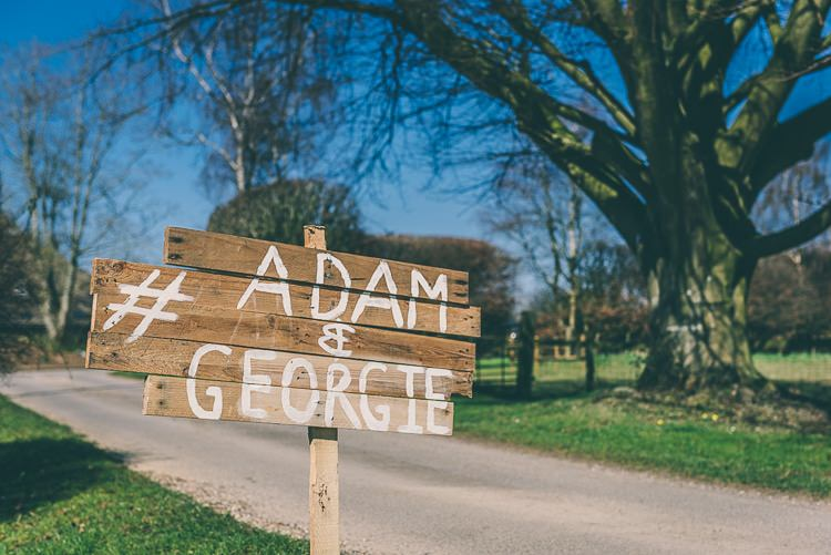 Rustic Wooden Sign Post Eclectic Colour Pop Barn Wedding http://www.robtarren.co.uk/