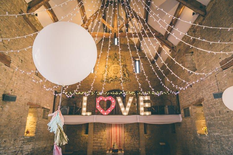Giant Balloon Tassels Eclectic Colour Pop Barn Wedding http://www.robtarren.co.uk/