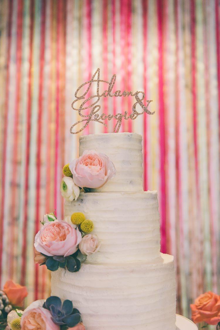 Ribbon Backdrop Cake Buttercream Flowers Eclectic Colour Pop Barn Wedding http://www.robtarren.co.uk/
