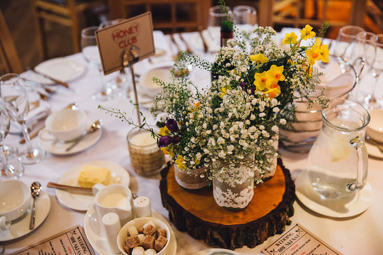 Jar Flowers Lace Log Centrepiece Decor Table Vintage Sports Rustic Yellow Barn Wedding http://www.redonblonde.com/